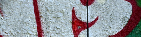 Street art. Abstract background image of a fragment of a colored graffiti painting in chrome and red tones. Stok Fotoğraf