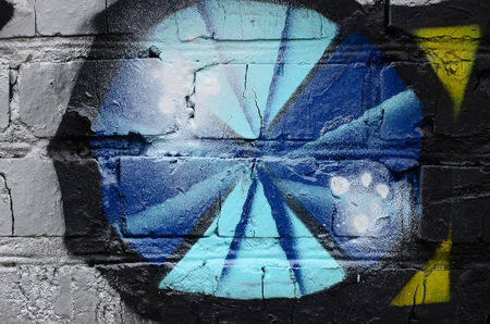Street art. Abstract background image of a fragment of a colored graffiti painting in chrome and blue tones.