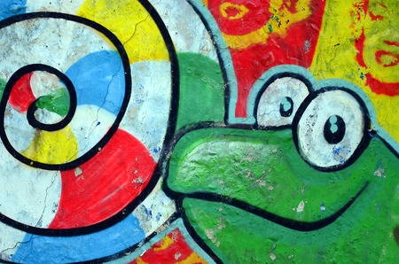 Street art. Abstract background image of a full completed graffiti painting with cartoon frog and lollipop. Stock Photo