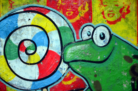 Street art. Abstract background image of a full completed graffiti painting with cartoon frog and lollipop. Stockfoto