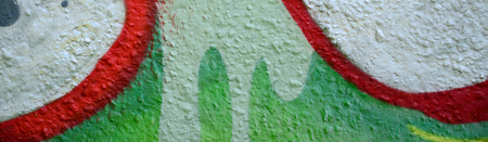 Street art. Abstract background image of a fragment of a colored graffiti painting in chrome and red tones. Stock Photo