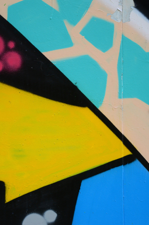Street art. Abstract background image of a fragment of a colored graffiti painting in blue tones. Stock Photo