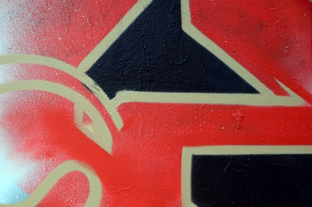 Street art. Abstract background image of a fragment of a colored graffiti painting in red tones. Stock Photo