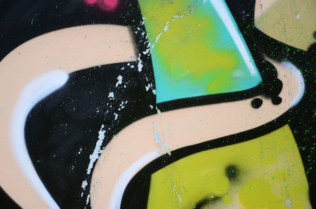 Street art. Abstract background image of a fragment of a colored graffiti painting in khaki green and orange tones.
