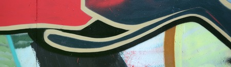 Street art. Abstract background image of a fragment of a colored graffiti painting in red tones. Stok Fotoğraf