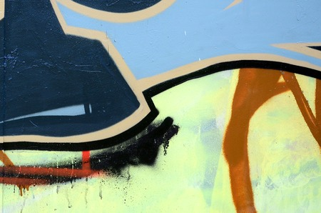 Street art. Abstract background image of a fragment of a colored graffiti painting in dark grey and red tones. Stok Fotoğraf
