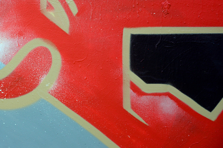 Street art. Abstract background image of a fragment of a colored graffiti painting in red tones. Фото со стока