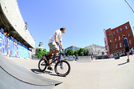 KHARKIV, UKRAINE - 27 MAY, 2018: Freestyle BMX riders in a skatepark during the annual festival of street cultures.