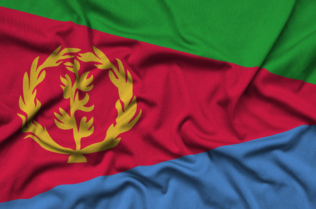 Eritrea flag  is depicted on a sports cloth fabric with many folds. Sport team waving banner Stock fotó