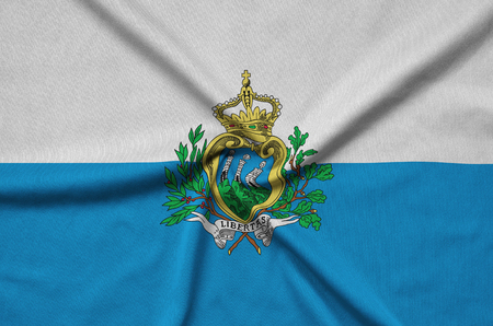 San Marino flag  is depicted on a sports cloth fabric with many folds. Sport team waving banner Reklamní fotografie