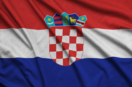 Croatia flag  is depicted on a sports cloth fabric with many folds. Sport team waving banner