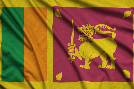 Sri Lanka flag  is depicted on a sports cloth fabric with many folds. Sport team waving banner Фото со стока