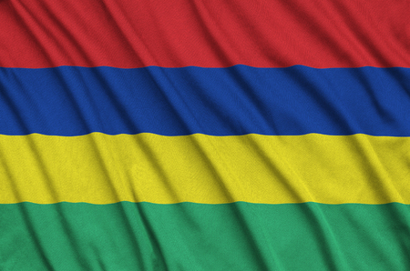 Mauritius flag  is depicted on a sports cloth fabric with many folds. Sport team waving banner