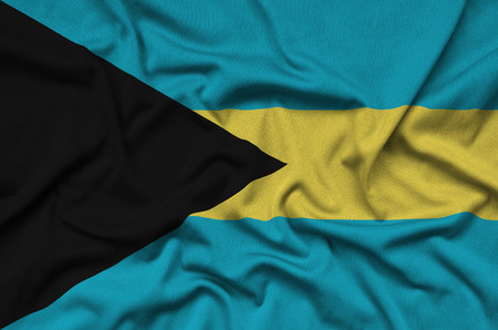 Bahamas flag  is depicted on a sports cloth fabric with many folds. Sport team waving banner