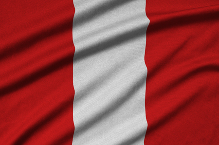 Peru flag is depicted on a sports cloth fabric with many folds. Sport team waving banner