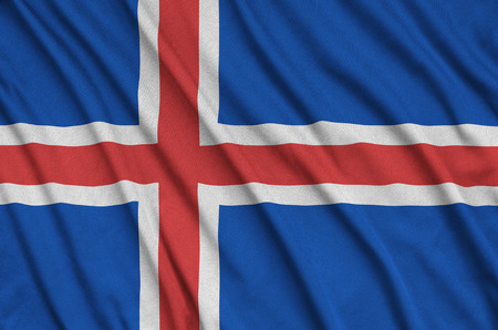 Iceland flag  is depicted on a sports cloth fabric with many folds. Sport team waving banner