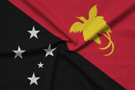 Papua New Guinea flag  is depicted on a sports cloth fabric with many folds. Sport team waving banner
