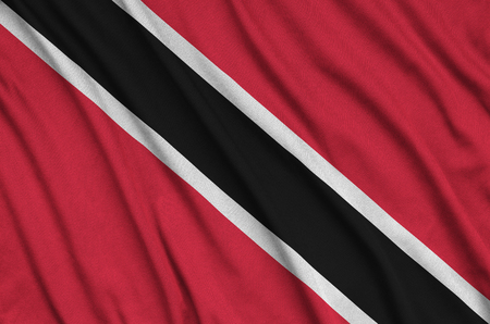 Trinidad and Tobago flag  is depicted on a sports cloth fabric with many folds. Sport team waving banner Stock Photo