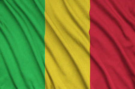 Mali flag  is depicted on a sports cloth fabric with many folds. Sport team waving banner Stock fotó