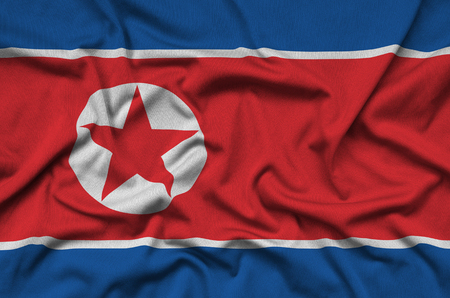 North Korea flag  is depicted on a sports cloth fabric with many folds. Sport team waving banner
