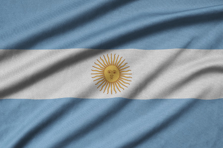 Argentina flag  is depicted on a sports cloth fabric with many folds. Sport team waving banner