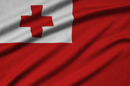 Tonga flag  is depicted on a sports cloth fabric with many folds. Sport team waving banner