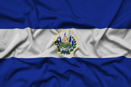 El Salvador flag  is depicted on a sports cloth fabric with many folds. Sport team waving banner Stock Photo