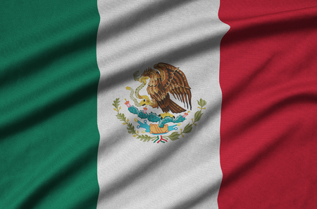 Mexico flag  is depicted on a sports cloth fabric with many folds. Sport team waving banner Reklamní fotografie