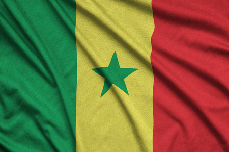 Senegal flag  is depicted on a sports cloth fabric with many folds. Sport team waving banner