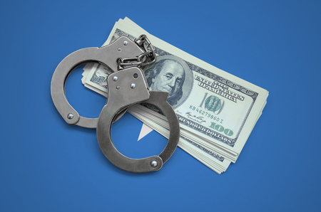 Somalia flag  with handcuffs and a bundle of dollars. Currency corruption in the country. Financial crimes. 版權商用圖片 - 104809555