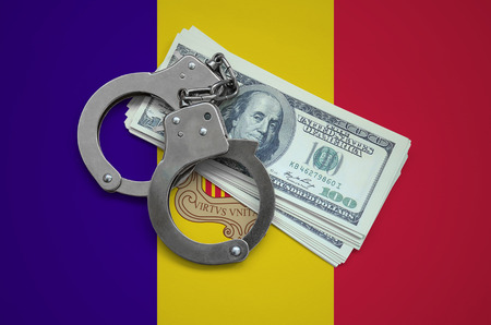 Andorra flag  with handcuffs and a bundle of dollars. Currency corruption in the country. Financial crimes. 스톡 콘텐츠