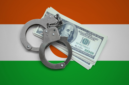 Niger flag  with handcuffs and a bundle of dollars. Currency corruption in the country. Financial crimes.