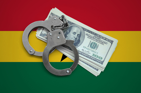 Ghana flag  with handcuffs and a bundle of dollars. Currency corruption in the country. Financial crimes. 版權商用圖片