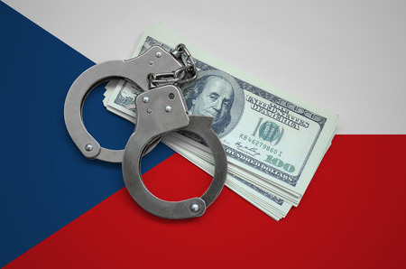 Czech flag  with handcuffs and a bundle of dollars. Currency corruption in the country. Financial crimes. 版權商用圖片