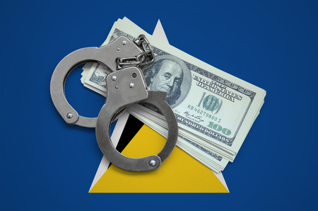 Saint Lucia flag  with handcuffs and a bundle of dollars. Currency corruption in the country. Financial crimes.