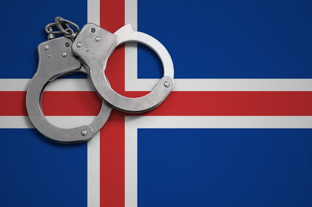 Iceland flag  and police handcuffs. The concept of crime and offenses in the country. Banco de Imagens