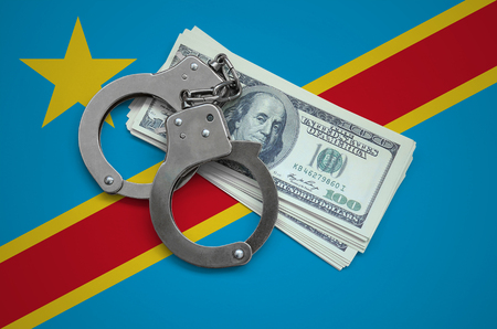 Democratic Republic of the Congo flag  with handcuffs and a bundle of dollars. Currency corruption in the country. Financial crimes.