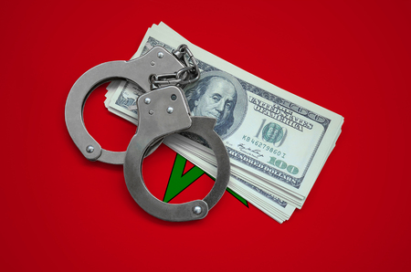 Morocco flag  with handcuffs and a bundle of dollars. Currency corruption in the country. Financial crimes.