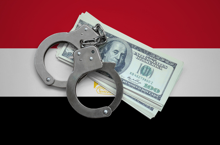 Egypt flag  with handcuffs and a bundle of dollars. Currency corruption in the country. Financial crimes. 版權商用圖片 - 105271595