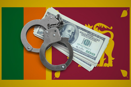 Sri Lanka flag  with handcuffs and a bundle of dollars. Currency corruption in the country. Financial crimes.