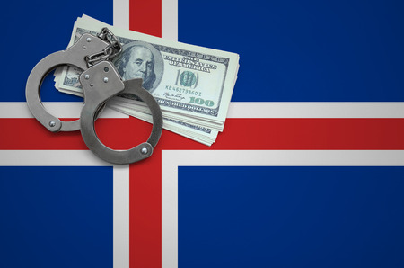 Iceland flag  with handcuffs and a bundle of dollars. The concept of breaking the law and thieves crimes.