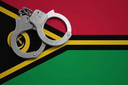 Vanuatu flag  and police handcuffs. The concept of crime and offenses in the country. Banco de Imagens