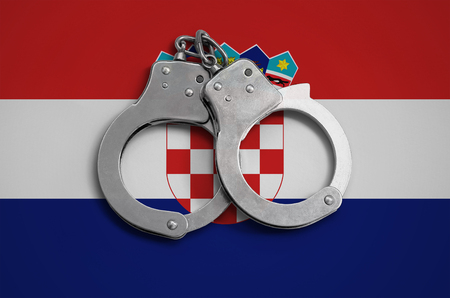 Croatia flag  and police handcuffs. The concept of observance of the law in the country and protection from crime. Stock Photo