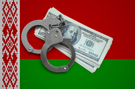 Belarus flag  with handcuffs and a bundle of dollars. Currency corruption in the country. Financial crimes. 版權商用圖片 - 105271771