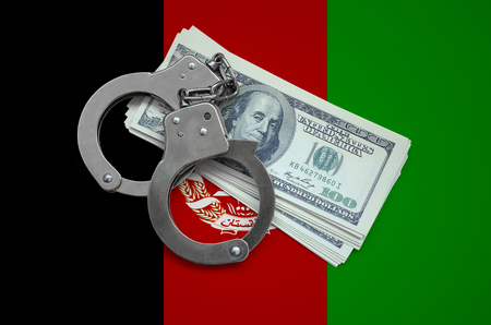Afghanistan flag with handcuffs and a bundle of dollars. Currency corruption in the country. Financial crimes. 版權商用圖片 - 105267972