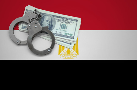 Egypt flag  with handcuffs and a bundle of dollars. The concept of breaking the law and thieves crimes. Banco de Imagens