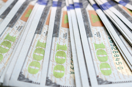 Macro shot with shallow depth of field. Hundred US dollar bills. Stock Photo