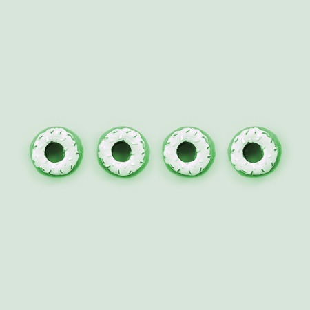 Many small plastic donuts lies on a pastel colorful background. Flat lay minimal pattern. Top view. Stock Photo