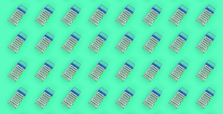 Small stainless steel graters lies on a pastel colored paper. Kitchen accessories. Tools for cooking. Flat lay top view.