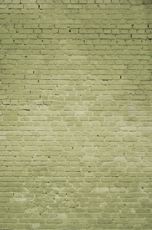 The texture of the brick wall of many rows of bricks painted in yellow color
